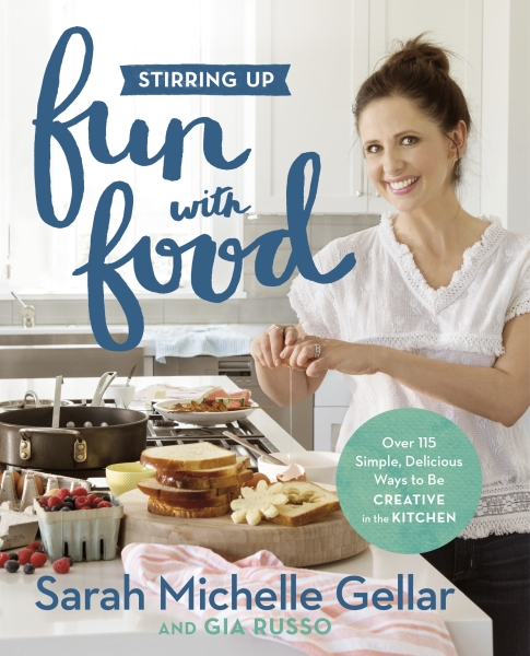 "This cover image released by Grand Central Life & Style shows ""Stirring Up Fun with Food: Over 115 Simple, Delicious Ways to Be Creative in the Kitchen,"" by Sarah Michelle Gellar and Gia Russo. - AP"