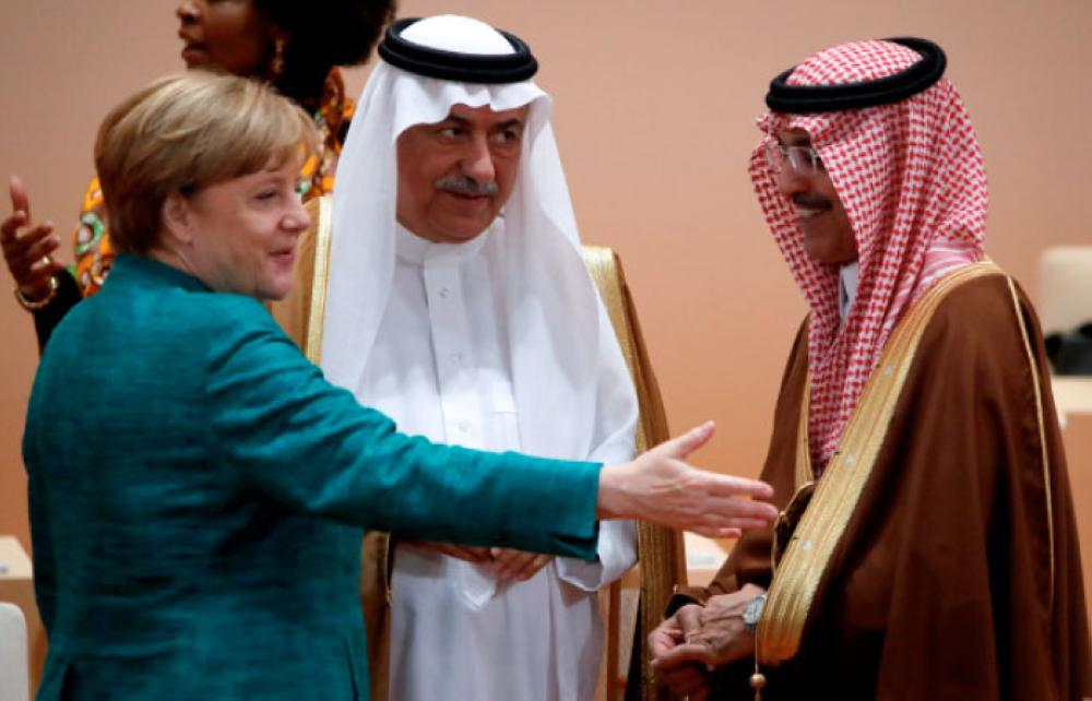 German Chancellor Angela Merkel talks to Saudi Finance Minister Mohammed Al-Jadaan next to Saudi Arabia Minister of State Ibrahim Abdulaziz Al-Assaf during a working session at the G20 leaders summit in Hamburg, Germany, on Saturday. — Reuters