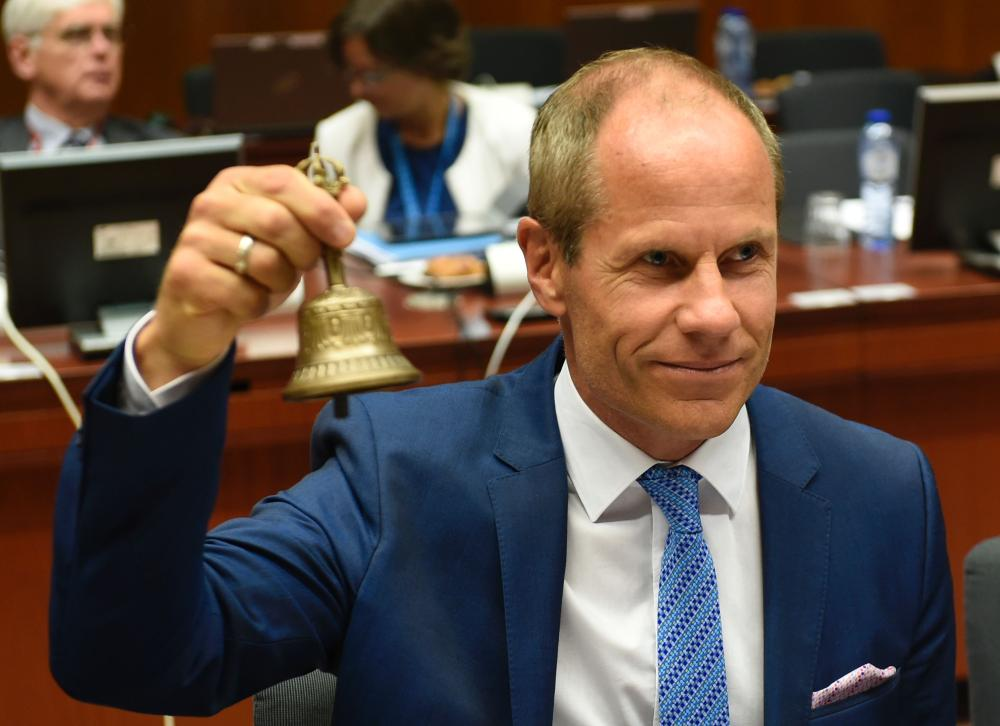 Toomas Toniste rings the bell during an Ecofin meeting at the EU headquarters in Brussels on July 11, 2017. — AFP