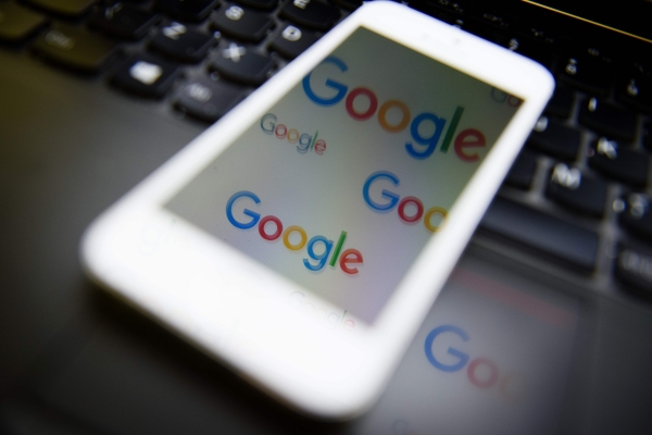 This file photo tshows the logo of US technology company and search engine Google displayed on screens. — AFP
