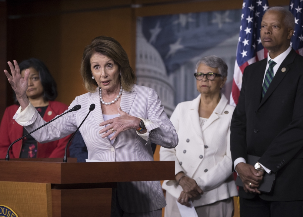 House Minority Leader Nancy Pelosi, left, participates in a news conference on Capitol Hill in Washington on Friday to renew calls for a vote on an independent commission to investigate Russia's election meddling and ties to the Trump administration. — AP