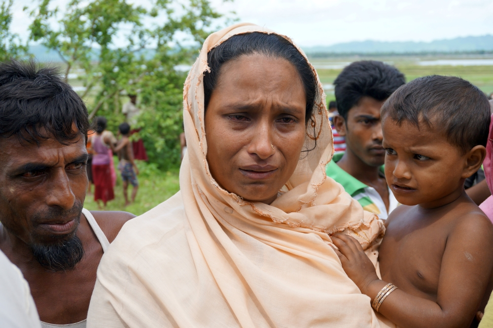 Sarbeda, whose teenage son was arrested for suspected links to a militant group, speaks to reporters in Kyar Gaung Taung village, northern Rakhine state, Myanmar, on Saturday. — Reuters