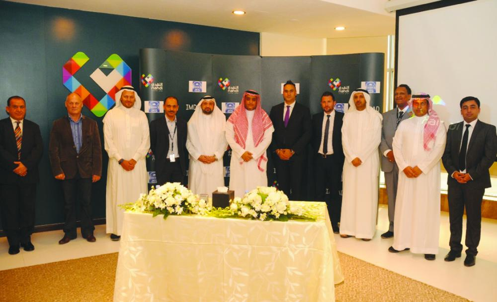 Top executives of Al Nahdi Medical Company and Al-Hamdan Consultation Office pose for a group after the signing of agreement