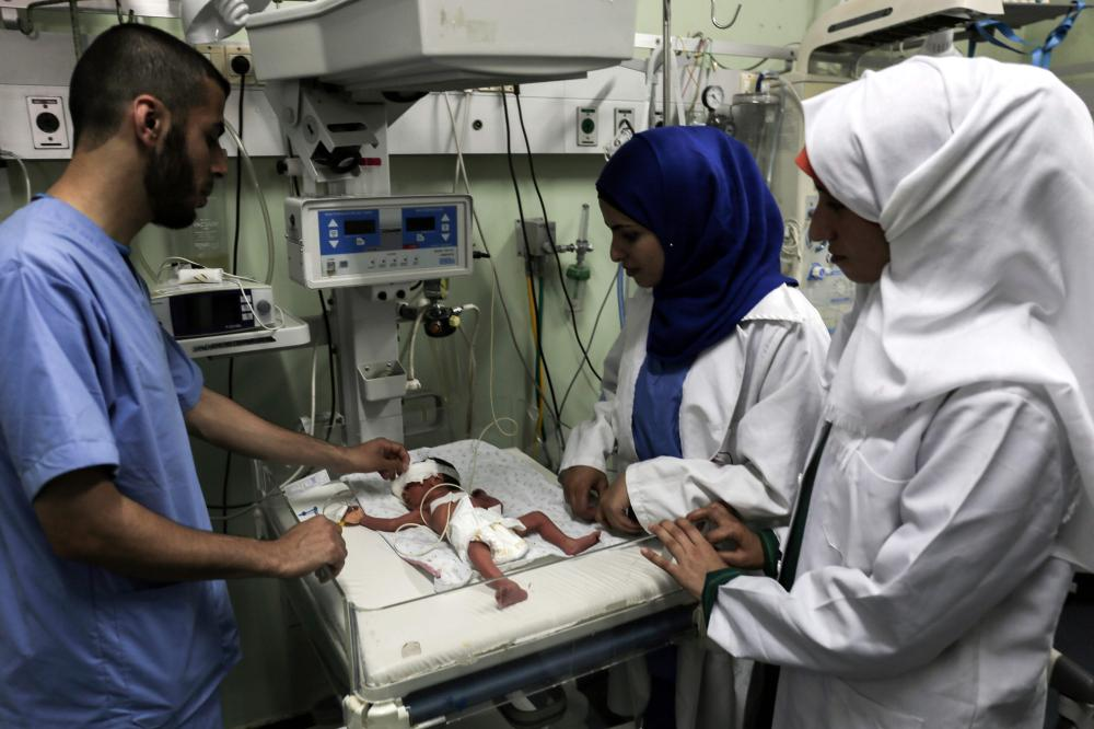 Palestinian nurses tend to a newborn at the neonatal intensive care unit at the UAE hospital in Rafah in the southern Gaza Strip. Hamas accused the Palestinian Authority and Israel of refusing to grant documents to Gazans in need of permission to seek medical treatment outside the blockaded coastal enclave. — AFP