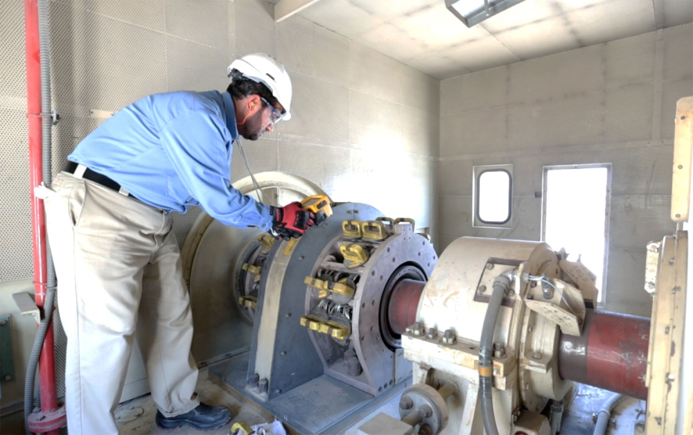 One of the Saudi electricity cadres  carries out technical maintenance at the station