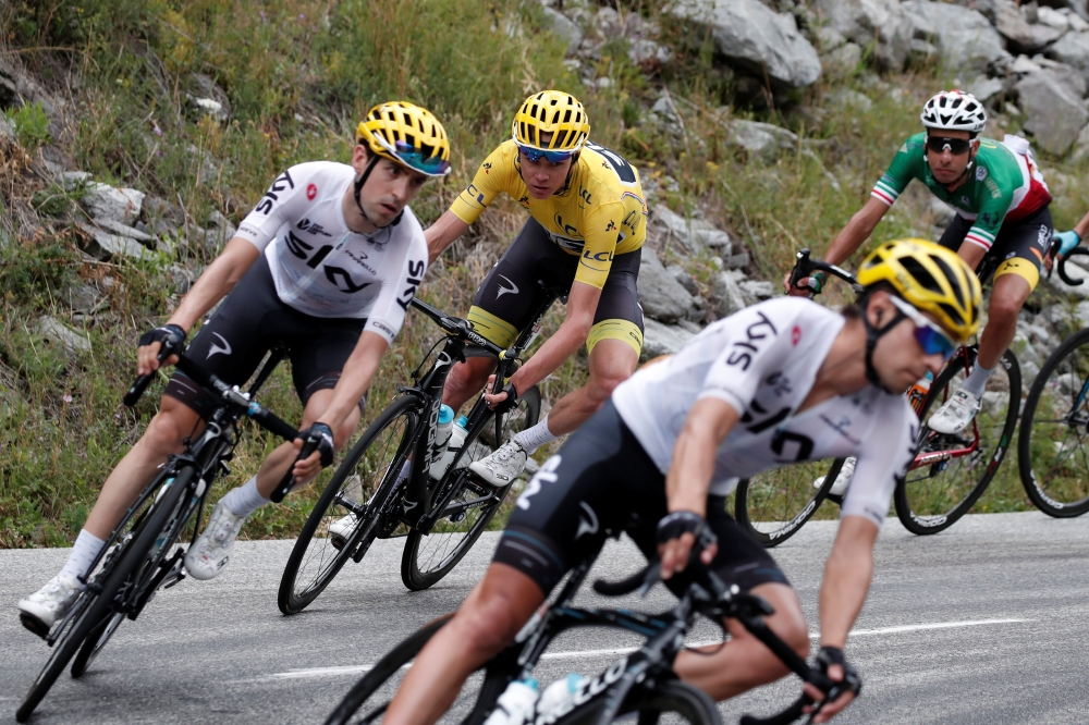 Team Sky rider and yellow jersey holder Chris Froome of Britain in action in the 104th Tour de France cycling race during the 183-km Stage 17 from La Mure to Serre-Chevalier, France, on Wednesday. — Reuters