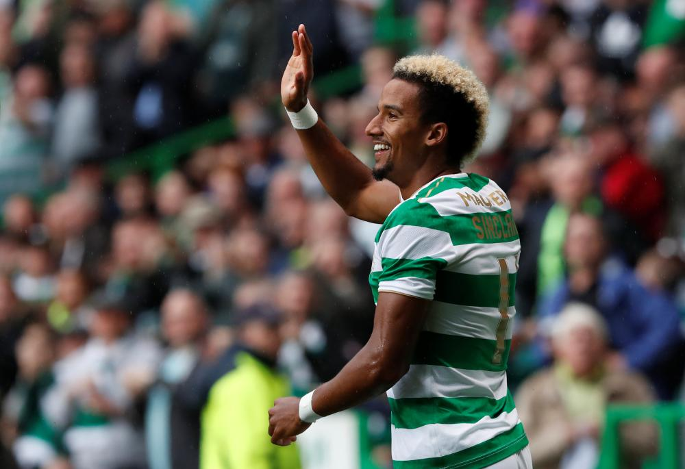 Celtic's Scott Sinclair celebrates scoring goal against Linfield during the UEFA Champions League qualifying match in Glasgow Wednesday. — Reuters