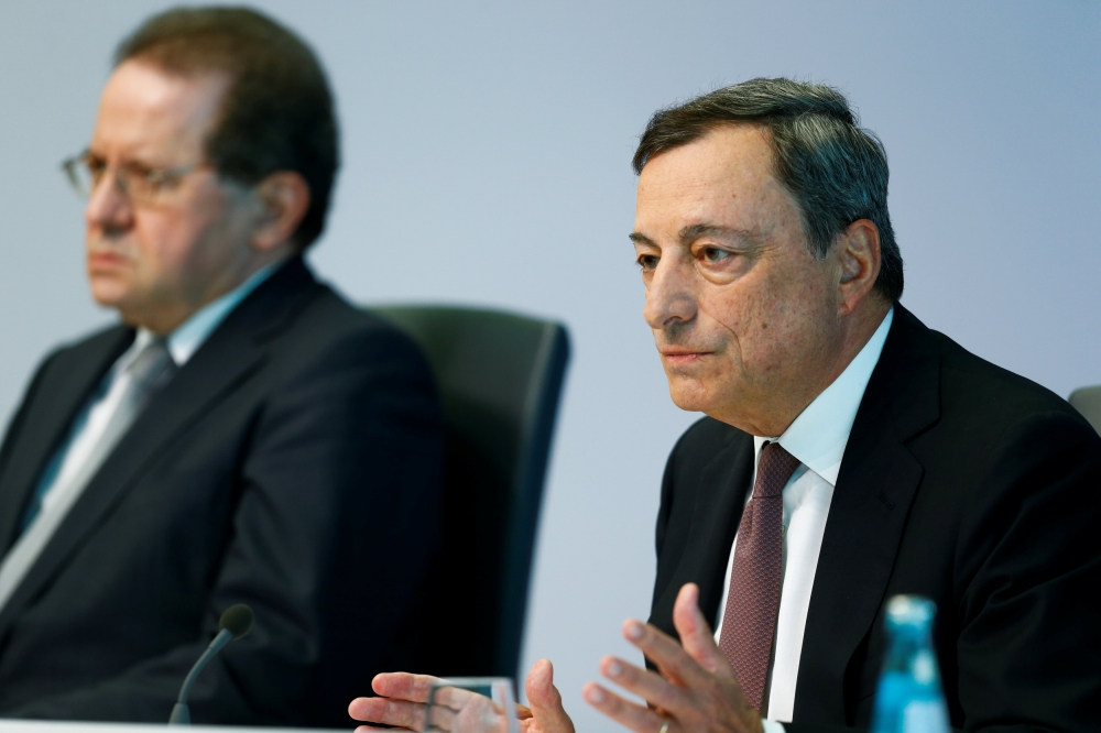 European Central Bank (ECB) President Mario Draghi (R) and Vice President Vitor Constancio address a news conference at the ECB headquarters in Frankfurt, Germany on Thursday.  — Reuters