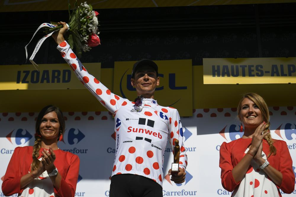 France's Warren Barguil celebrates his polka dot jersey of best climber on the podium at the end of the 179,5 km 18th stage of the 104th edition of the Tour de France cycling race between Briancon and Izoard, French Alps, Thursday. — AFP