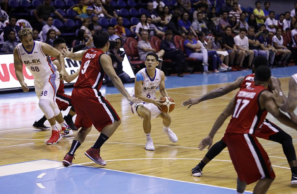 NLEX's Kevin Alas finds his way blocked by Alaska's Nonoy Baclao in their PBA Governor's Cup game at the Smart-Araneta Coliseum in Manila Wednesday night.