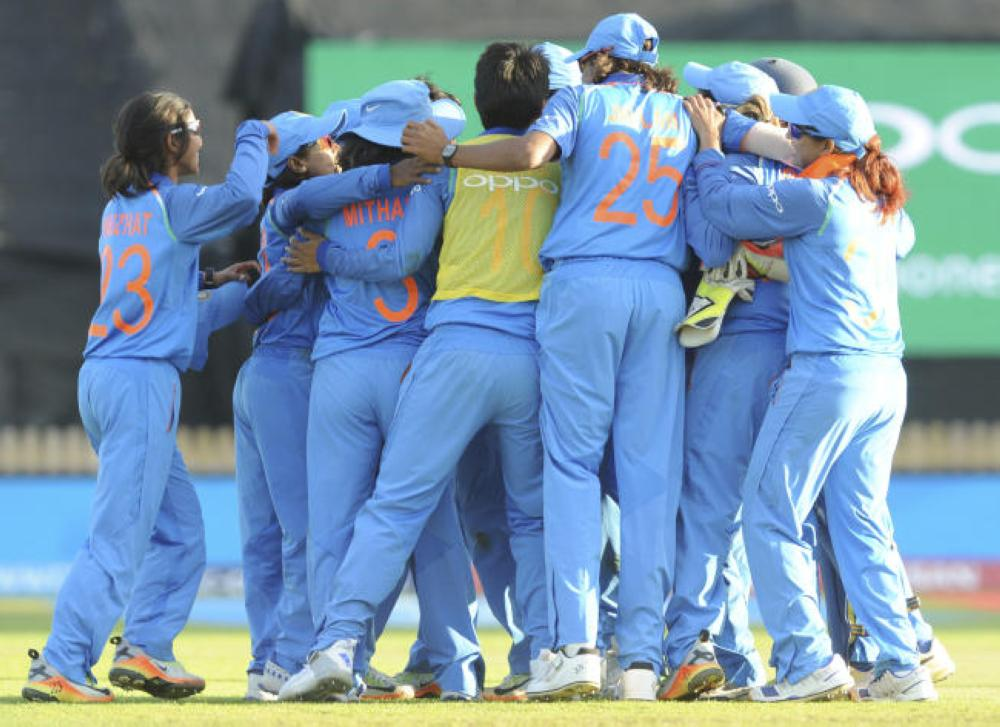 India players celebrate after beating Australia to reach the final during the ICC Women's World Cup 2017 semifinal match between Australia and India at County Ground in Derby, England, Thursday, July 20, 2017. — AP