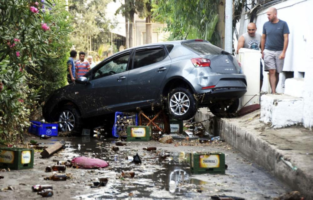 A car, damaged on the overnight Earthquake is seen in Bodrum, Turkey, Friday, July 21, 2017. — AP