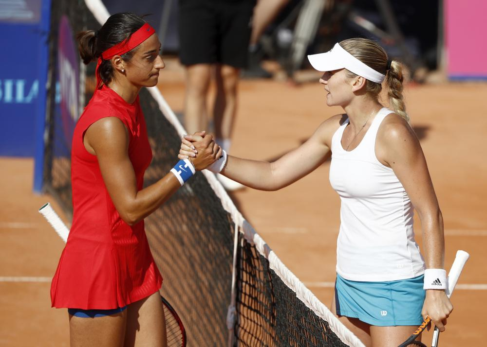 Caroline Garcia (L) of France and Tereza Martincova of the Czech Republic shake hands after their match at the WTA Ladies Championship Tennis Tournament in Gstaad, Switzerland, Thursday. — AP