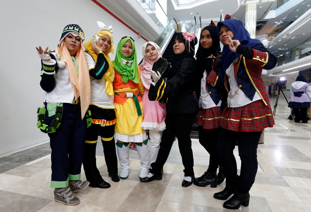 Muslim women cosplayers pose during a cosplay event at a mall in Petaling Jaya, near Kuala Lumpur, Malaysia. — Reuters