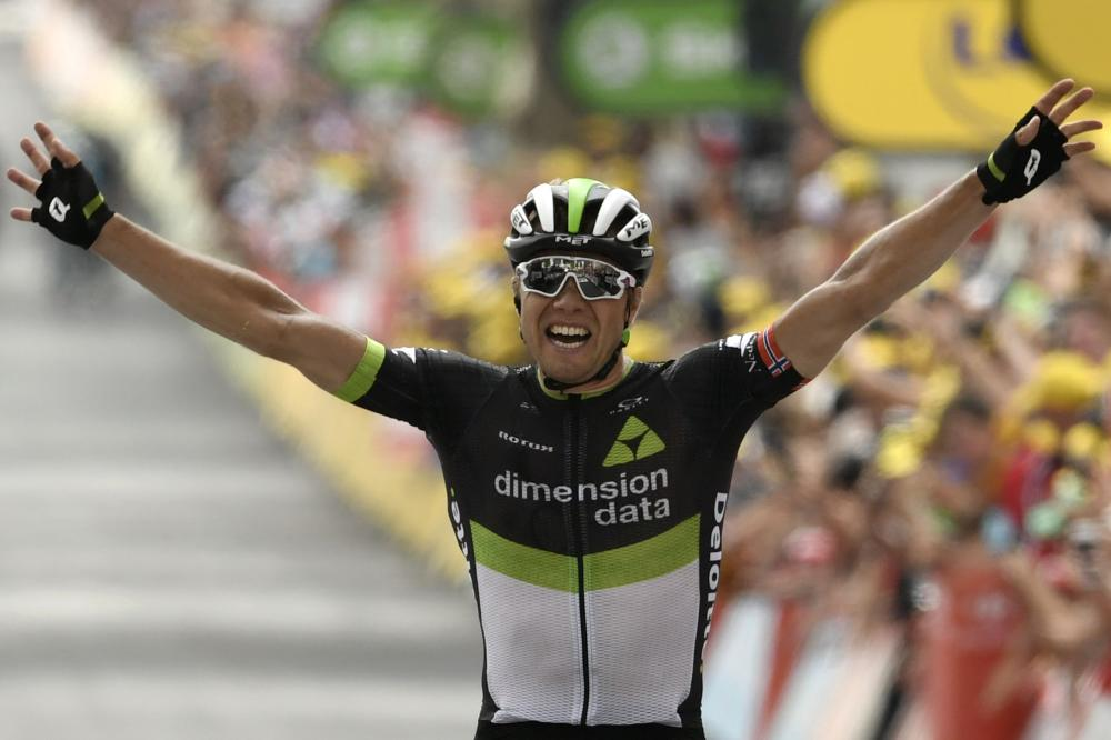 Norway's Edvald Boasson Hagen celebrates as he crosses the finish line at the end of the 222,5 km 19th stage of the 104th edition of the Tour de France cycling race between Embrun and Salon-de-Provence Friday. — AFP