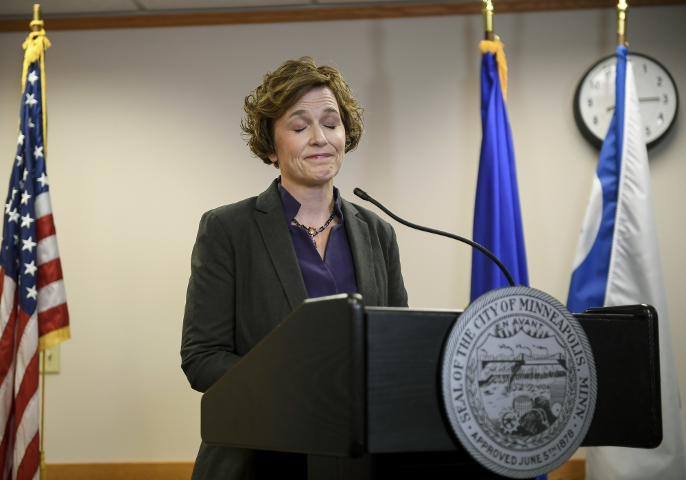 Minneapolis Mayor Betsy Hodges closes her eyes as she is shouted at by protesters during a press conference held to discuss the resignation of Minneapolis Police Chief Janee Harteau, at City Hall in Minneapolis, Minnesota, on Friday. — AP