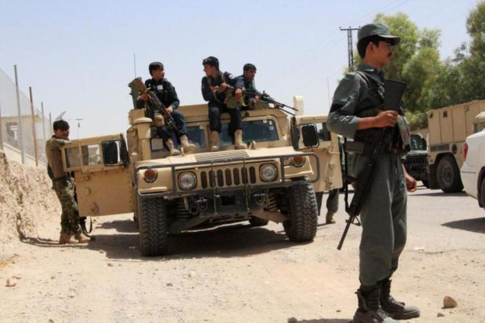 Afghan security personnel sit on atop an armored vehicles amid an ongoing battle with Taliban militants in the Gereshk district of Helmand province on Saturday. — AFP