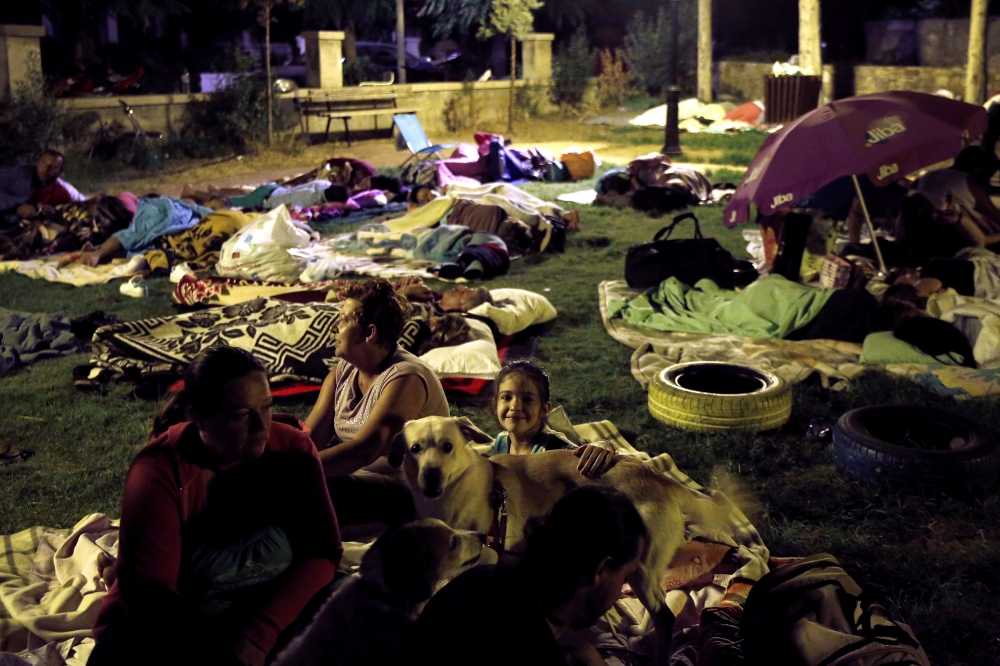 A family prepares to sleep in a park after an earthquake off the island of Kos, Greece, on Saturday. — Reuters