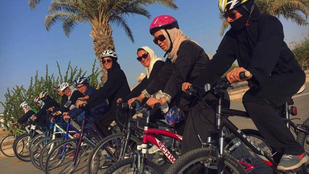 Women cyclists ride around the Corniche wearing long pants and loose shirts with helmets carefully placed over their headscarves. — Courtesy: Al-Arabiya