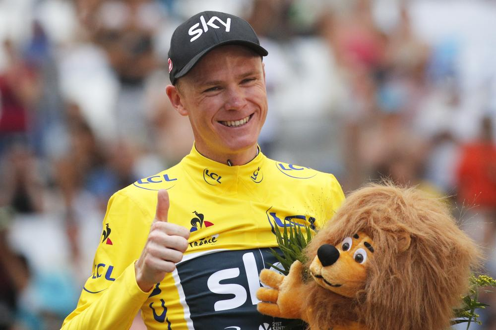 Britain's Chris Froome, wearing the overall leader's yellow jersey, flashes a thumbs up on the podium after the 20th stage of the Tour de France cycling race, an individual time trial over 22.5 kilometers with start and finish in Marseille, France, Saturday. — AP