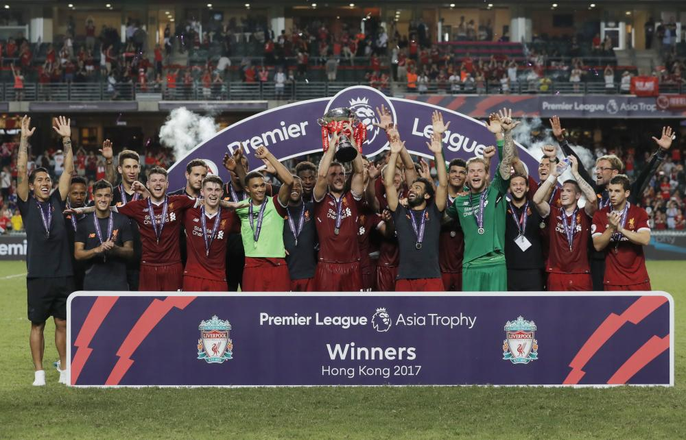 Liverpool players celebrate after winning the final match against Leicester City at the Premier League Asia Trophy Soccer Tournament in Hong Kong Saturday. — AP