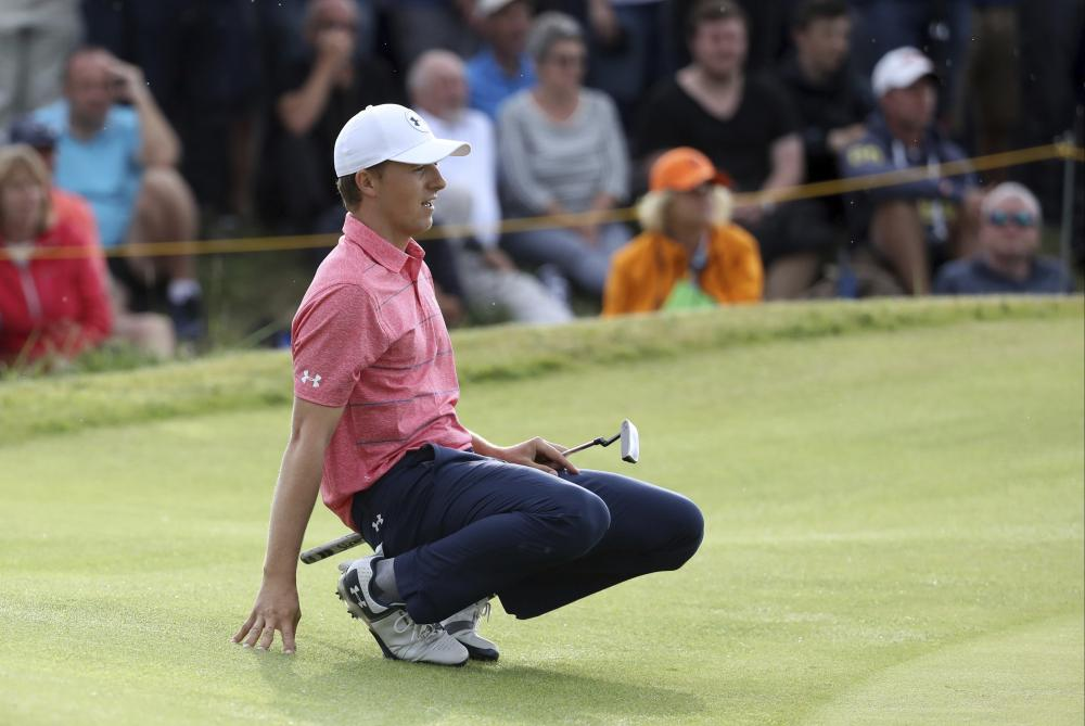 Jordan Spieth of the US watches his putt on the 15th green during the third round of the British Open Golf Championship at Royal Birkdale, Southport, England, Saturday. — AP