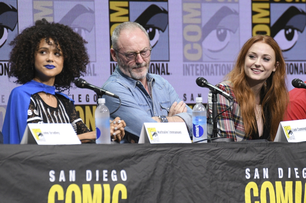 From left, actors Nathalie Emmanuel, Liam Cunningham, and Sophie Turner attend the