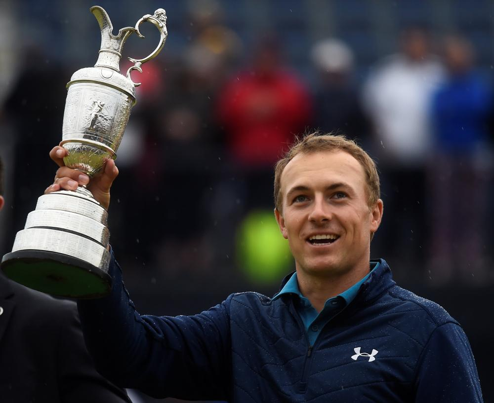 Jordan Spieth of the US celebrates with The Claret Jug after winning the British Open Golf Championship in Southport, London, Sunday. — Reuters