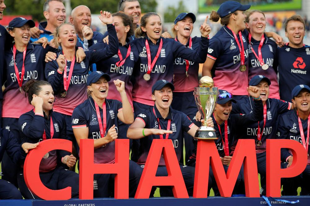 England's players celebrate winning the Women's Cricket World Cup after beating India in the final in London Sunday. — Reuters
