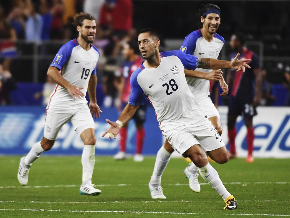 United States' Clint Dempsey (28) celebrates with teammates after scoring a goal during their CONCACAF Gold Cup semifinal match against Costa Rica in Arlington, Texas, Saturday. — AP