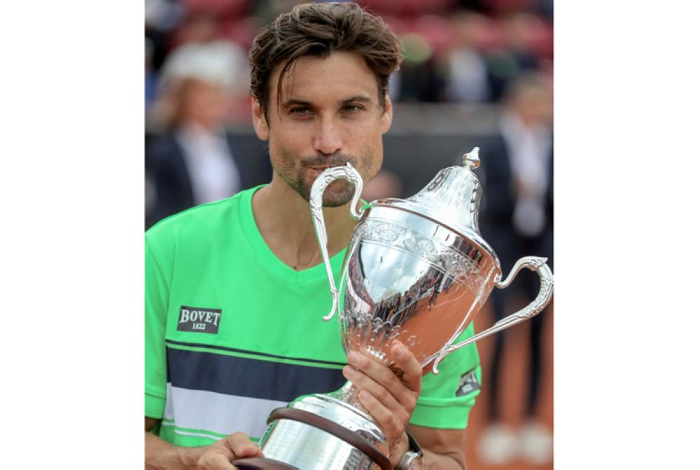 David Ferrer of Spain poses with the trophy after winning against Alexandr Dolgopolov of Ukraine in the final of the ATP Swedish Open in Bastad, Sweden, Sunday. — Reuters