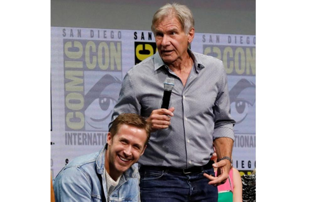 Cast members Ryan Gosling, left, and Harrison Ford participate in a panel for