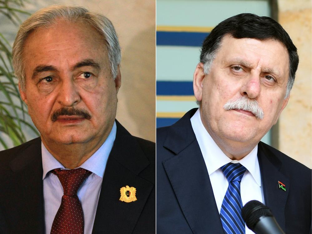 Khalifa Haftar (L) and Prime Minister Fayez Al-Sarraj