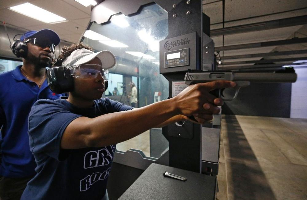 Shandrea Boyd, a 40-year-old physical therapist, said she wished she did not feel the need to carry a gun, but has learned to use one because so many others in Chicago are armed. - AFP