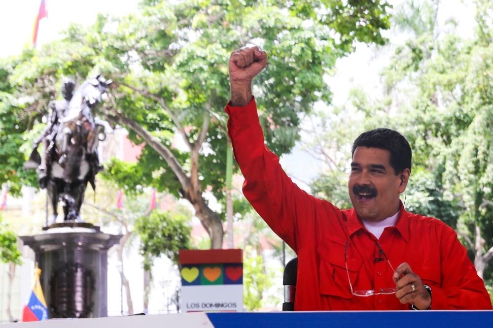 Venezuela's President Nicolas Maduro gestures while he speaks during his weekly broadcast in Caracas, Venezuela, on Sunday. — Reuters