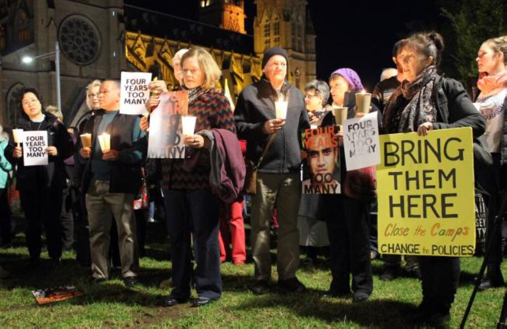 Participants of a vigil hold placards to show solidarity with the refugees and asylum seekers in PNG and Nauru camp in Sydney in this July 19, 2017 file photo. — AFP