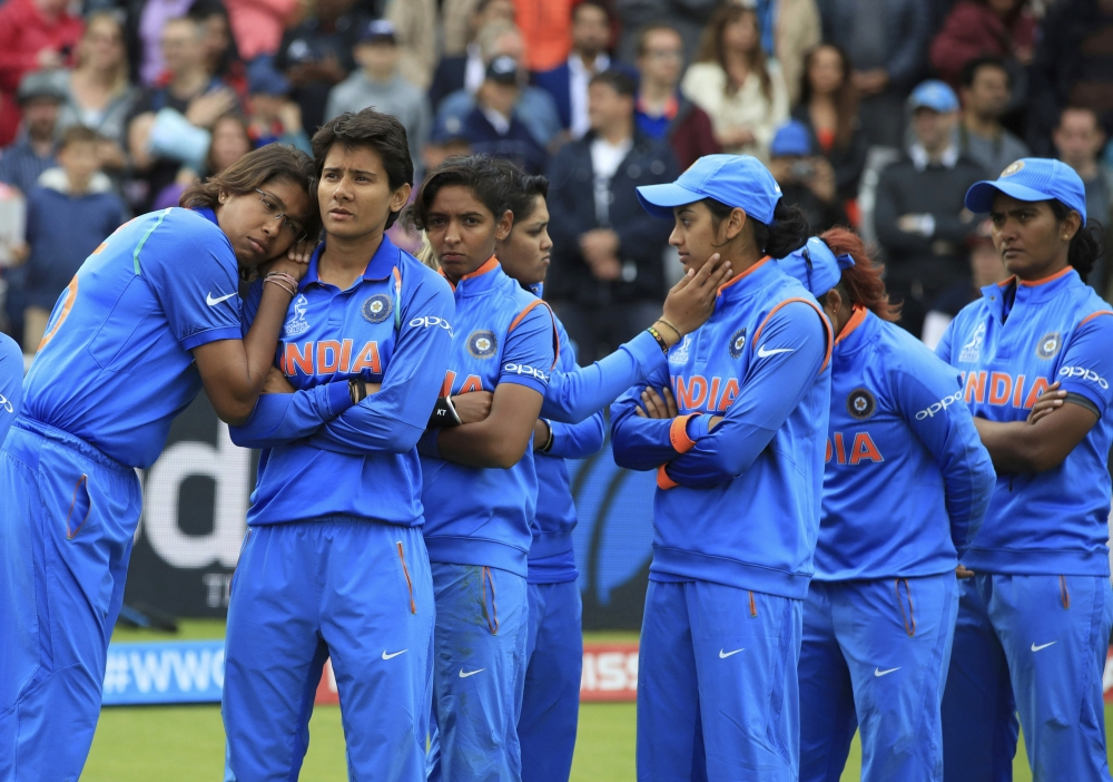India players stand dejected prior to receiving their runners-up medals after losing the ICC Women's World Cup final match against England, at Lord's, in London, Sunday. — AP