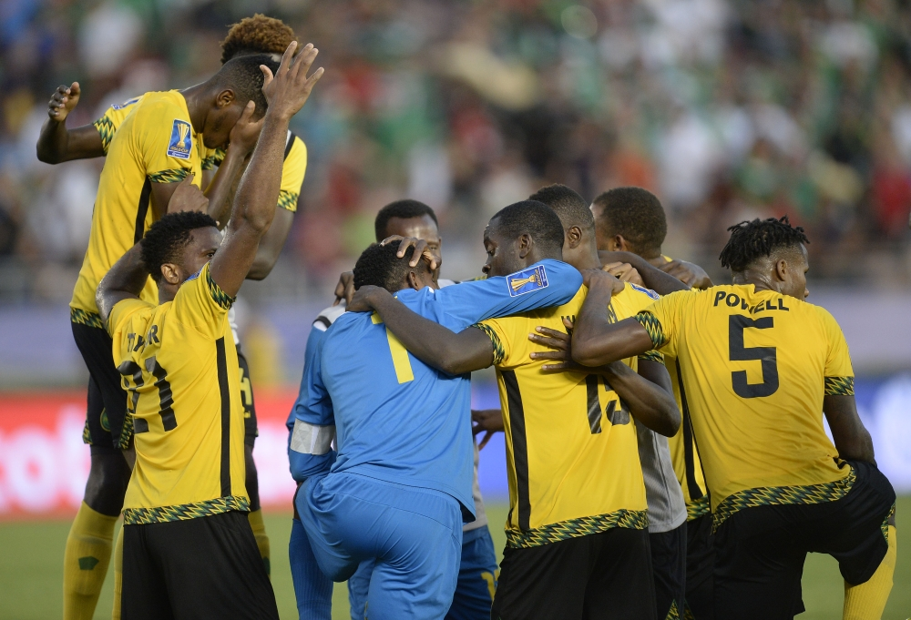 Jamaica celebrates the 1-0 victory against Mexico following the second half at Rose Bowl. The win sent them to the CONCACAF Gold Cup final. — Reuters