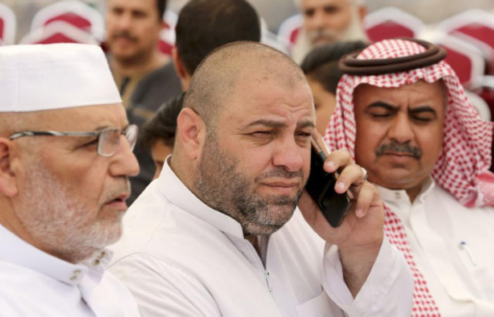 Zakariya Jawawdah, center, the father of Mohammed Jawawdah, a 17-year-old Jordanian, who was killed on Sunday evening by an Israeli security guard, speaks on the phone at a funeral tent in Amman, Jordan, Monday. — AP
