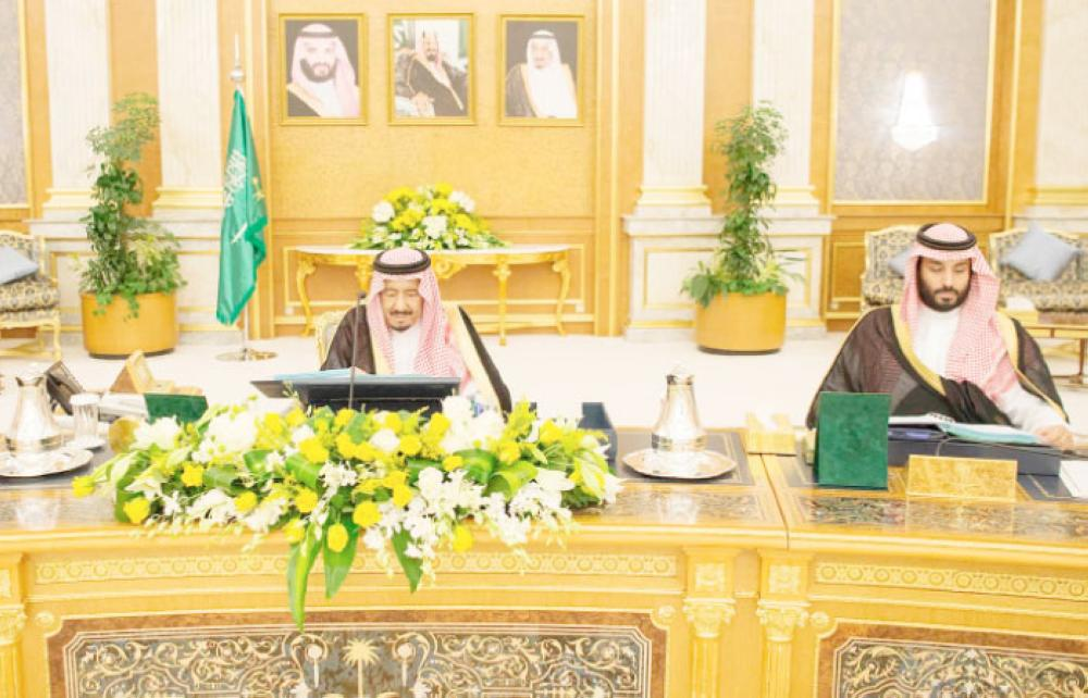Custodian of the Two Holy Mosques King Salman addresses the Cabinet's session at Al-Salam Palace in Jeddah on Monday as Crown Prince Muhammad Bin Salman, deputy premier and minister of defense, looks on. — SPA