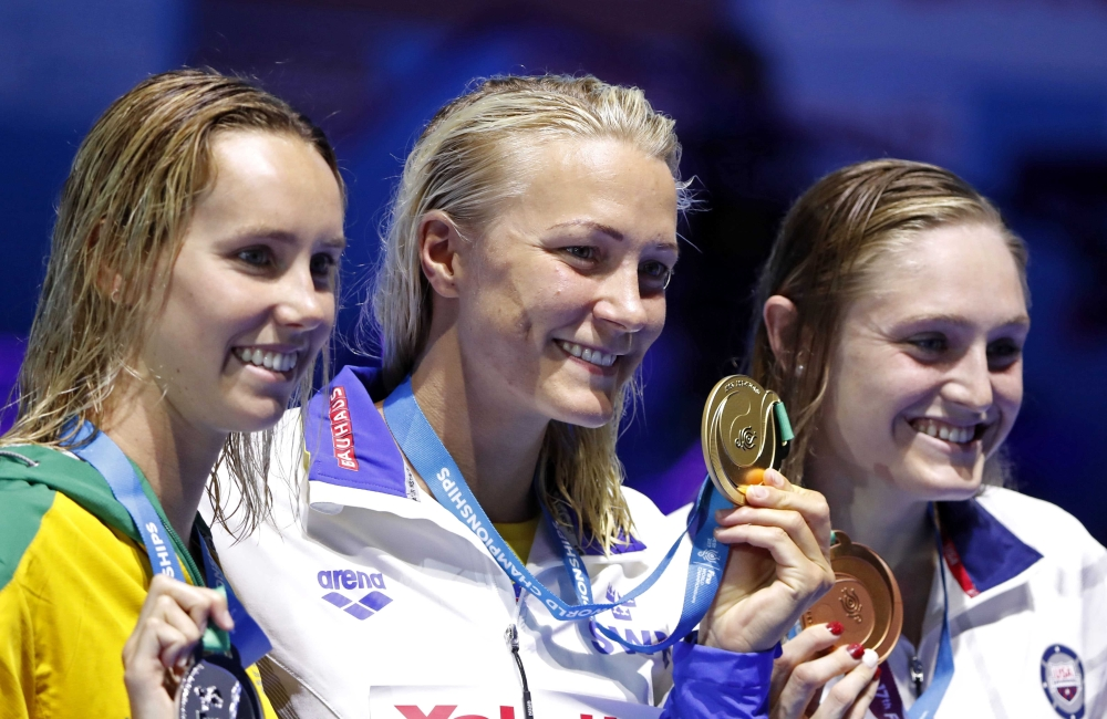 From (L-R) Emma McKeon (silver) of Australia, Sarah Sjostrom (gold) of Sweden and Kelsi Worrell (bronze) of US pose with the medals after the Women's 100m Butterfly awarding ceremony at the 17th FINA World Aquatics Championships in Budapest on Monday. — Reuters