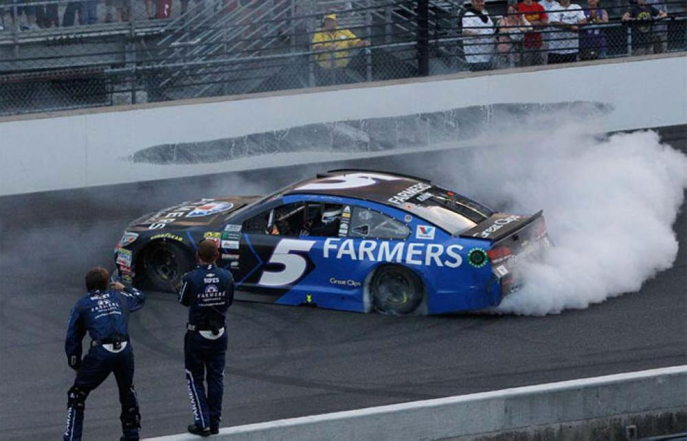 Kasey Kahne, driver of the No. 5 Farmers Insurance Chevrolet, celebrates with a burnout after winning the Monster Energy NASCAR Cup Series Brickyard 400 at Indianapolis Motorspeedway on Sunday in Indianapolis, Indiana. —AFP