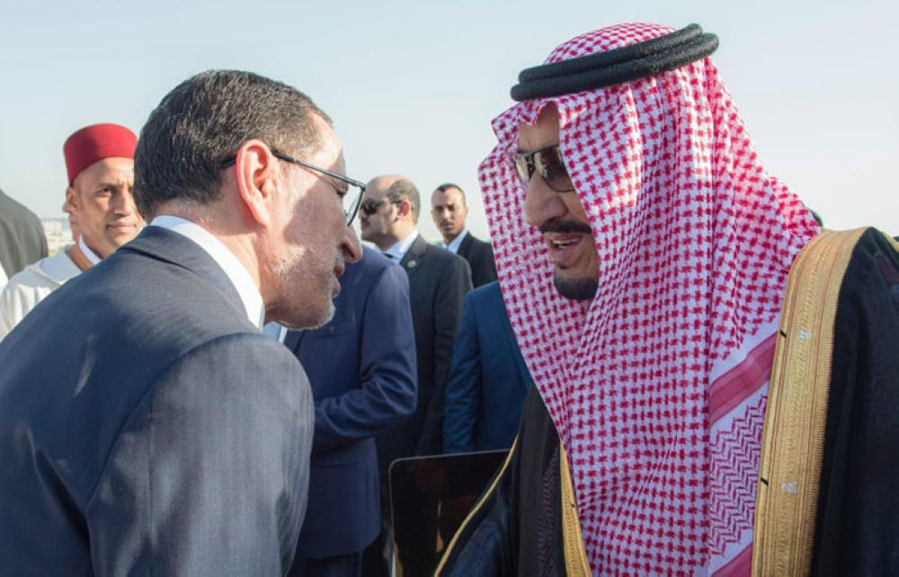 Morocco's Prime Minister Saadeddin Al-Othmani and other senior officials receive Custodian of the Two Holy Mosques King Salman at Ibn Battouta Airport in Tangier, Morocco on Monday evening. - SPA