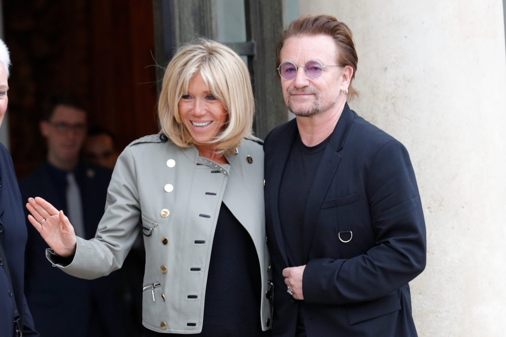 Singer Bono of Irish band U2 and co-founder of ONE organization and Brigitte Macron, wife of the French President, speak at the Elysee Palace in Paris, France on Tuesday. - Reuters