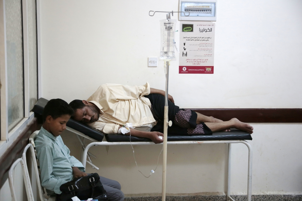 In this July 1, 2017, file photo, a man is treated for suspected cholera infection at a hospital in Yemen. — AP