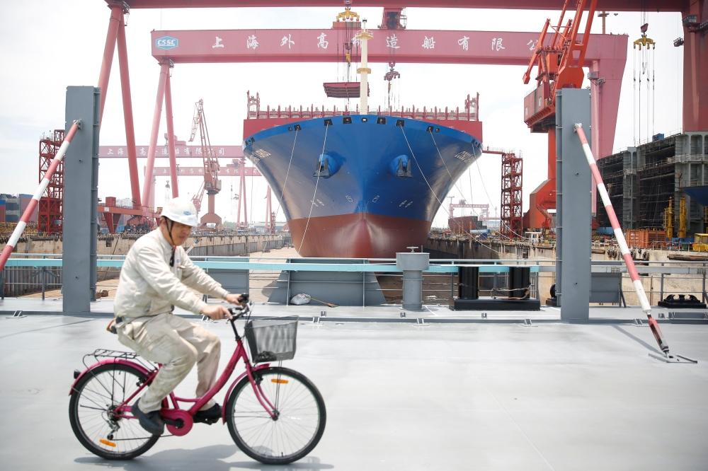 A laborer is seen at the Shanghai Waigaoqiao Shipbuilding Co., Ltd. shipyard in Shanghai, China. - Reuters