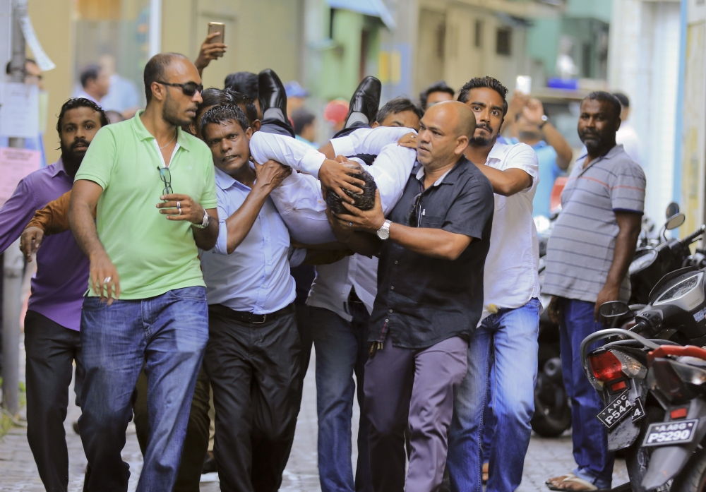 Maldivian lawmaker Faisal Naseem who was injured in clashes with police is rushed to a hospital in Male, Maldives, on Monday. — AP