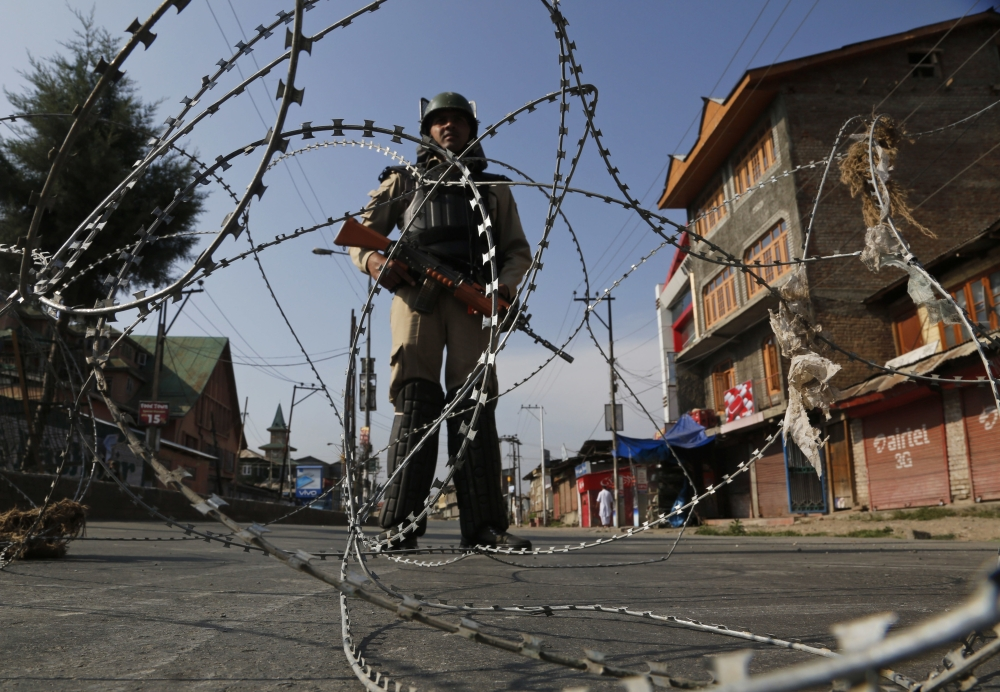 An Indian paramilitary soldier stands guard at a temporary check point during restrictions in Srinagar, Indian controlled Kashmir, on Tuesday. — AP