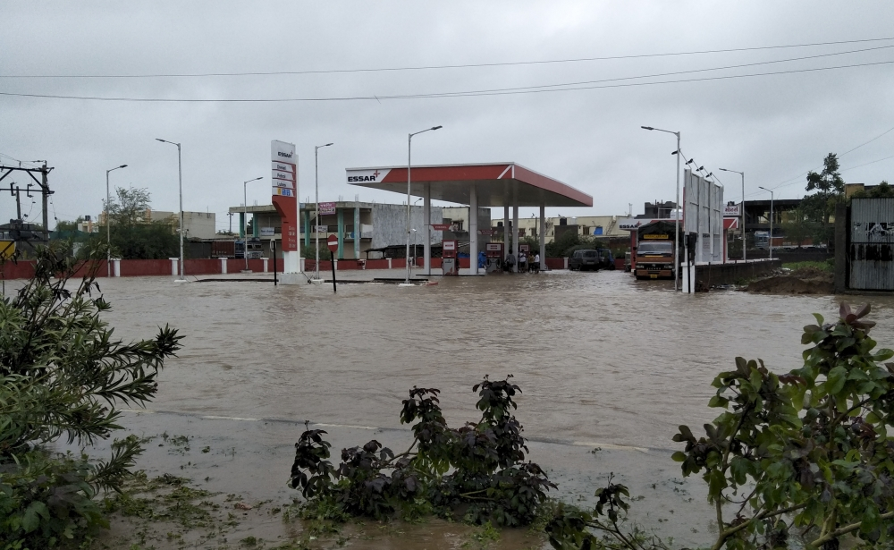 A fuel pump is surrounded by flood waters following heavy monsoon rains in Deesa, Gujarat, India, on Tuesday. — AP