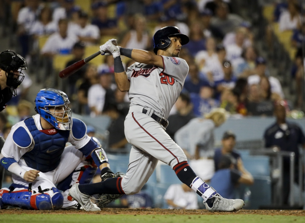 Minnesota Twins' Eddie Rosario hits an RBI double during the seventh inning of a baseball game against the Los Angeles Dodgers, Monday, in Los Angeles. — AP